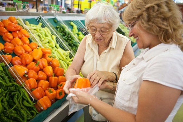 Senior-Woman-Shopping-with-Caregiver
