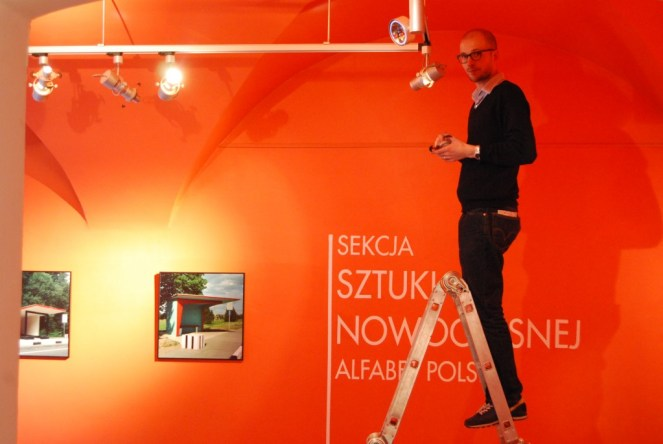 Nicolas Grospierre installing his artwork at Polish Aphabet project, 2009, from the archive of BWA Tarnów