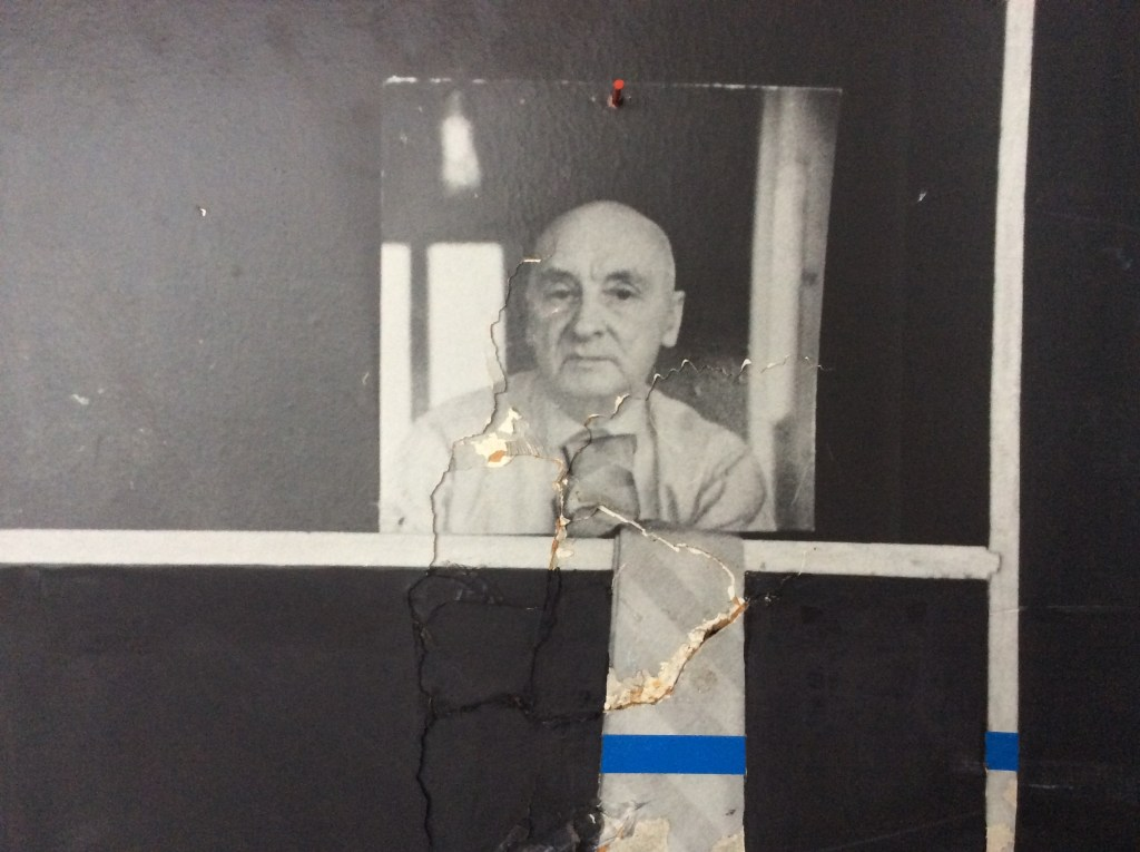 A photograph of Henryk Stażewski, with blue-taped tie. Edward Krasiński's studio apartment, Warsaw, Poland, 2016 PrevNext
