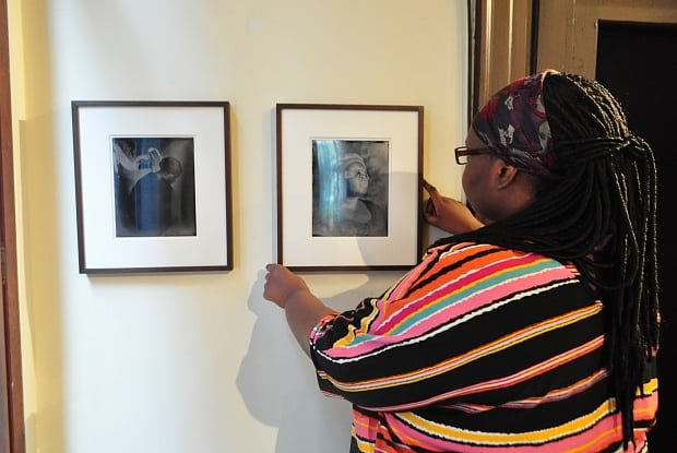 Khadija Saye positioning her work Dwelling: in this space we breathe (2017) (Image: Izzy Castro)