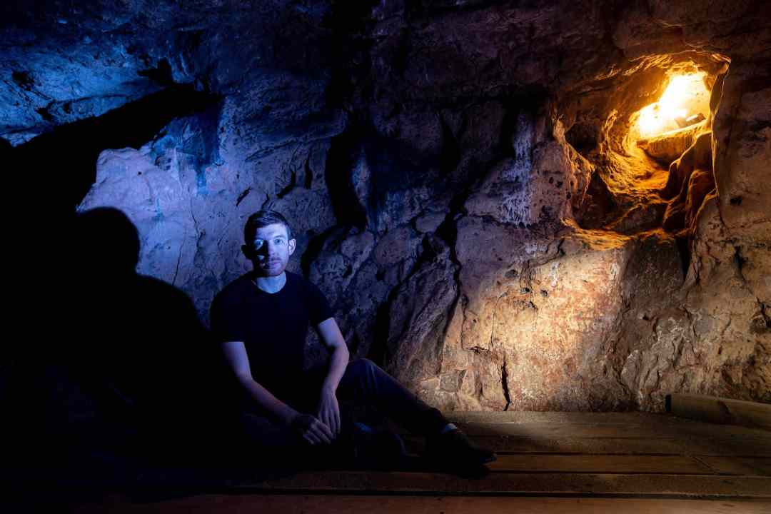 AlanJames Burns inside Creswell Crags Cave by Stephen Garnett_Charlotte Graham Photography