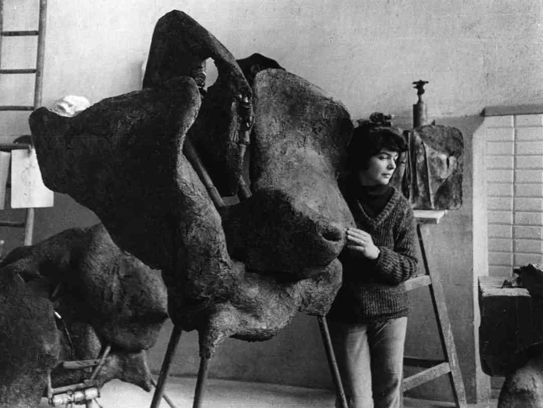 Alina Szapocznikow in her Père-Lachaise studio, Paris, FR with her work 'Sculpture avec une roue tournante (Sculpture with a Rotating Wheel),' 1963-1964 ca. 1963, Photographer: Władysław Sławny