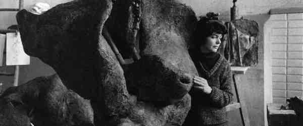 Alina Szapocznikow in her Père-Lachaise studio, Paris, FR with her work 'Sculpture avec une roue tournante (Sculpture with a Rotating Wheel),' 1963-1964 ca. 1963, Photographer: Władysław Sławny