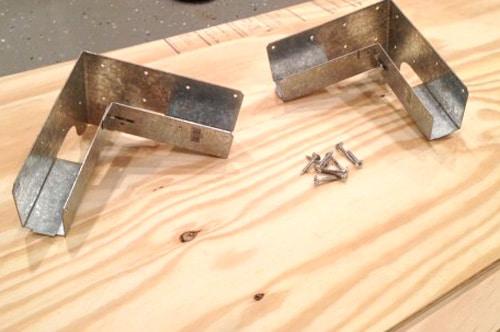 Elbow tie with screws.