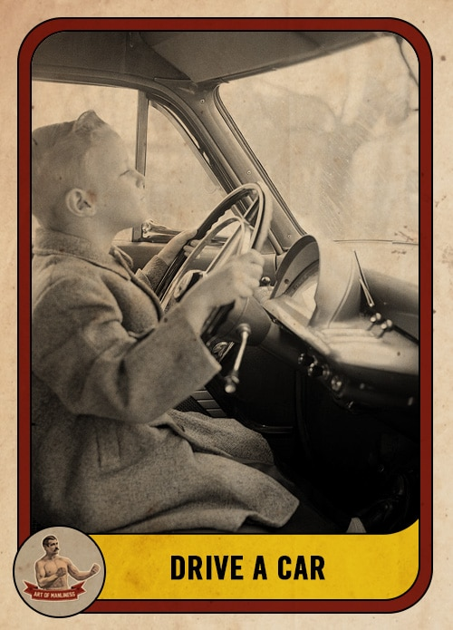vintage boy at the steering wheel of a car driving