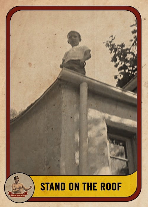 vintage boy standing on the roof of a house