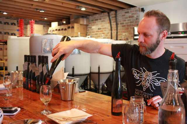 Glenn Lavender pours a sample of mead at the Silver Hand Meadery, Virginia
