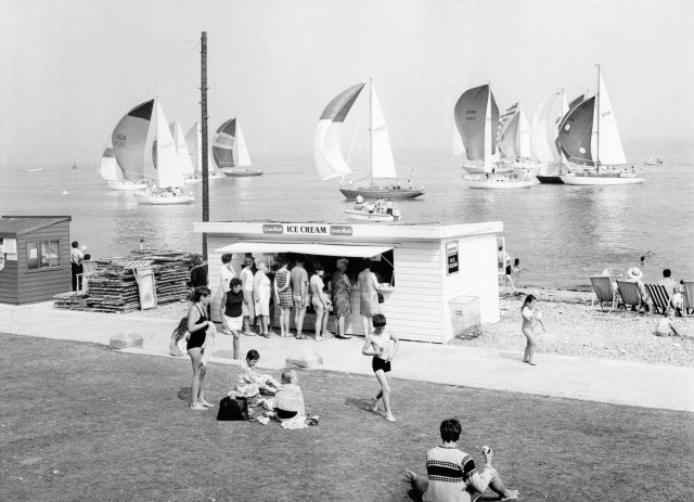 Holidaymakers queue up to buy ice cream on a hot summer's day at Cowes on the Isle of Wight.