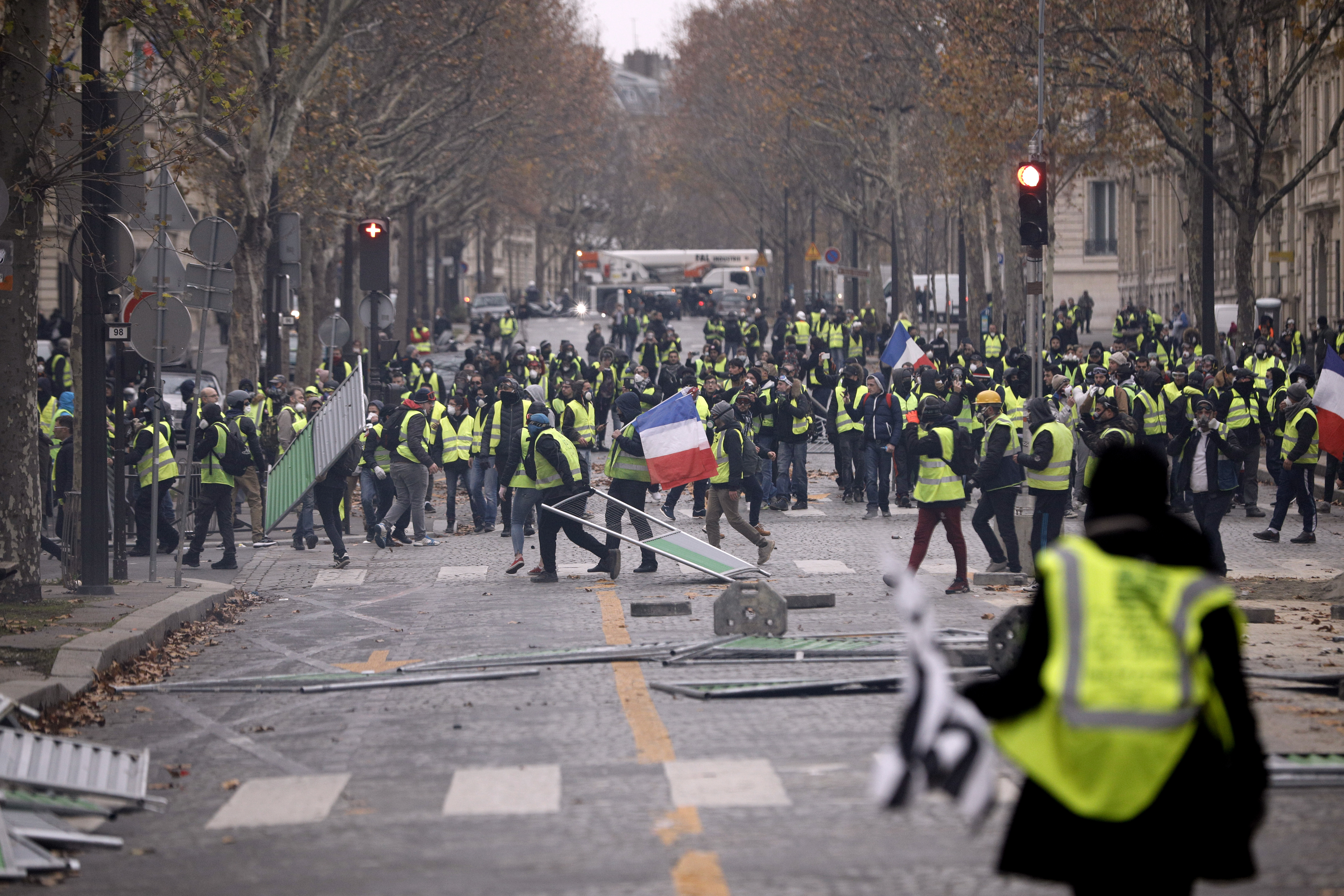 Demonstrators build a barricade near the Champs-Elysees during a demonstration  Hundreds arrested after Paris protest riot 305f8d01 2b5b 4c48 bc77 7028567c59b8