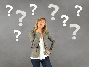 woman surrounded by question marks