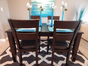 a dining room table with blue placemats