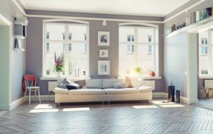 Spacious open living room filled with natural light.