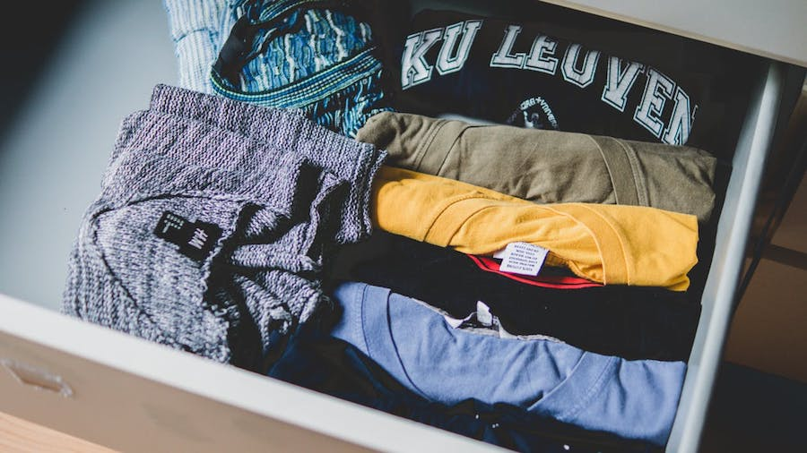 A drawer filled with t-shirts.