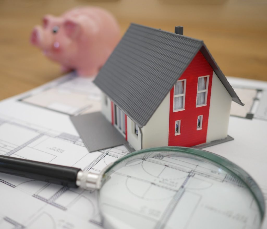 Piggy bank and house figure