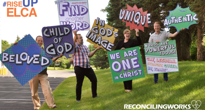 ReconcilingWorks Staff hold up youth gathering signs