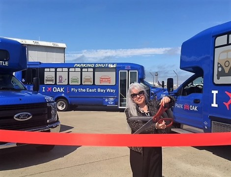 Alma Pena Cuts Ribbon on Blue Shuttles