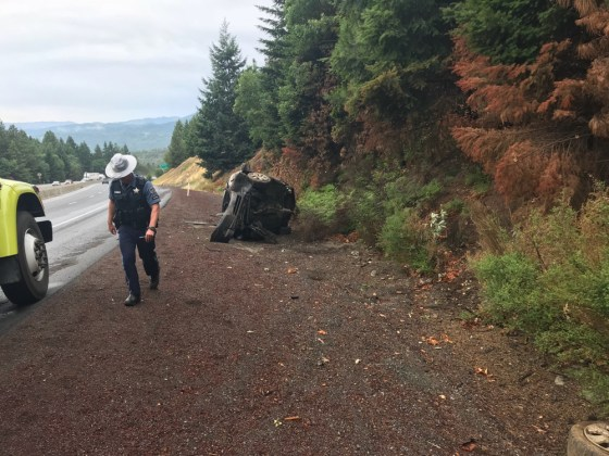 OSP Trooper assists a motorist who crashed on Interstate 5, MP 70 after a first season rain.