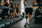 Row of treadmills with person with disability walking alongside them