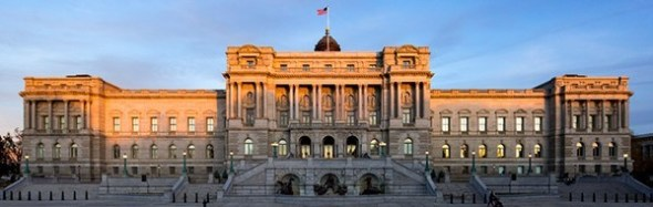 A panoramic shot of the Library of Congress with the sun setting in the background