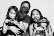 A family wearing masks during the Covid-19 pandemic