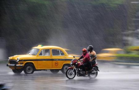 The first rains of the monsoon season fall in India – a slideshow
