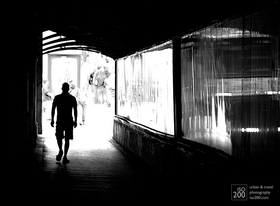 A man walks underneath the railway tracks at the end of Yonge Street, Toronto.