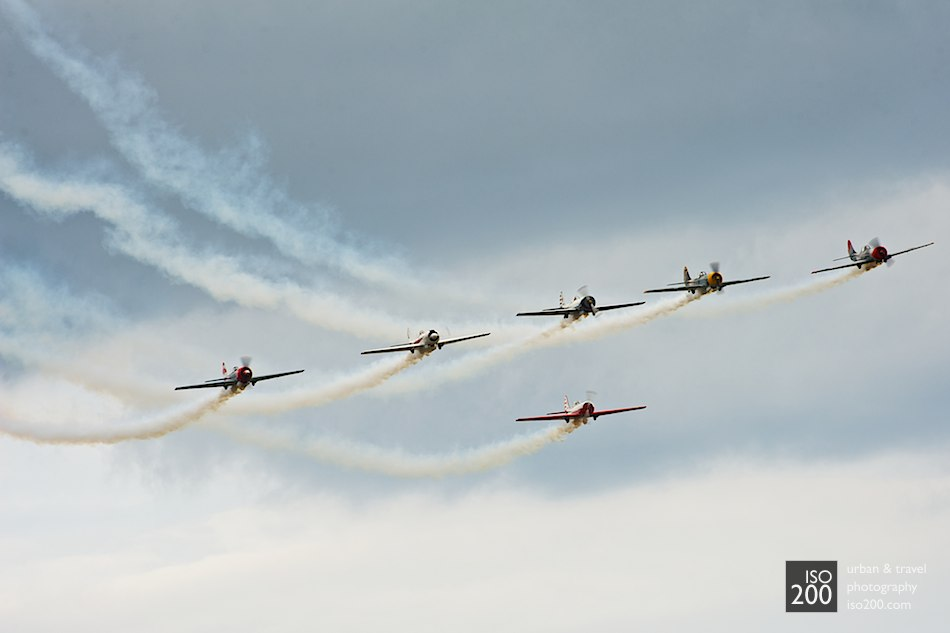 Six Yak 50s from the Aerostar Yak display team fly in formation.
