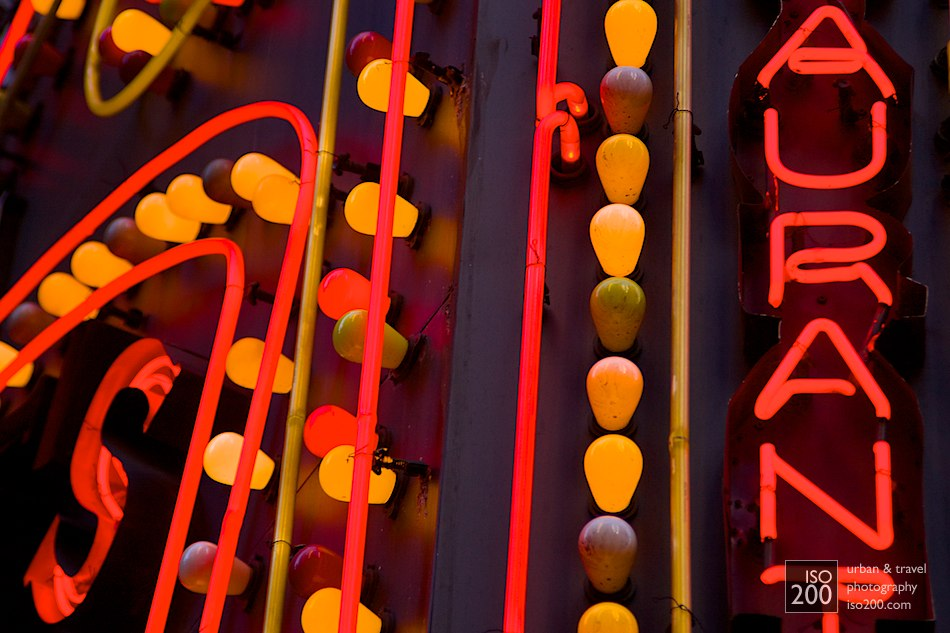 Lightbulbs and neon tubes make up the brightly lit sign for Maxie's Restaurant, Times Square, Manhattan.