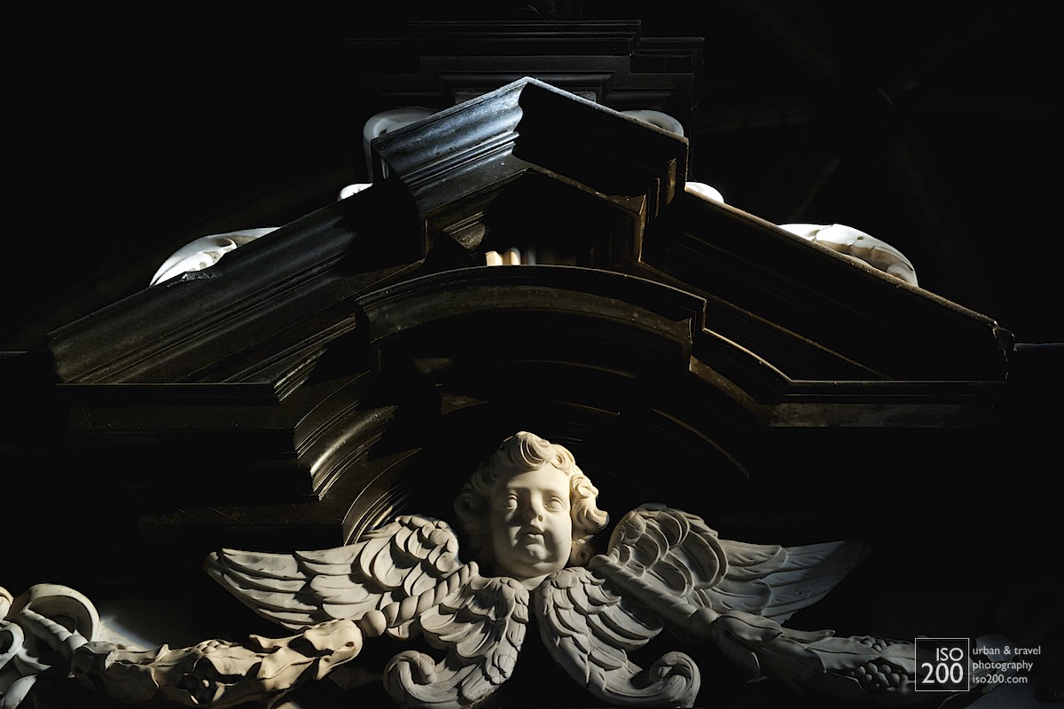 Cherub decoration on a tomb in the ambulatory behind the apse of the Saint Bavo Cathedral (also known as Sint-Baafs Cathedral, or Sint Baafskathedraal in Dutch).