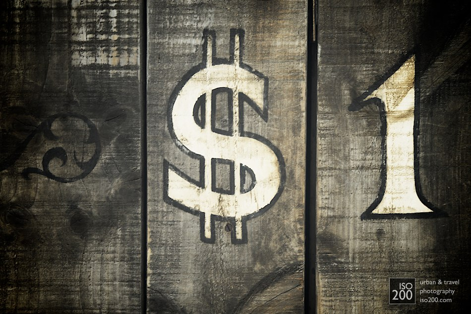 Photo of a faded dollar sign on a wooden background, Wild West, Morningside, Edinburgh.