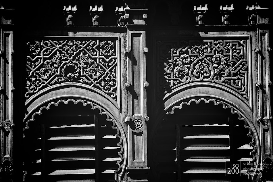 Detail of the windows that are part of the cast iron facade of the Ataranzas, Malaga's famous central market.