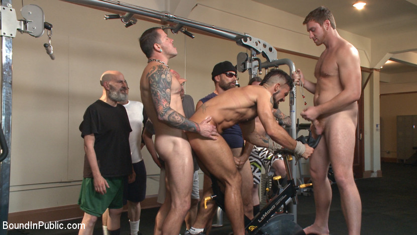 Horny gym goers dump their loads on a muscled gym rat - Bound in Public