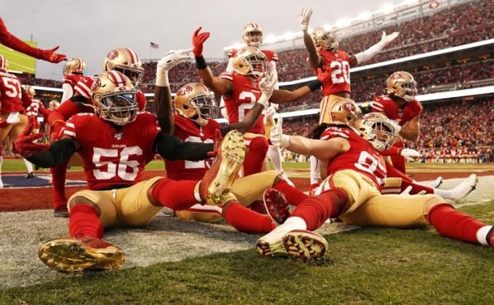 Photo of San Francisco 49er players celebrating a touchdown