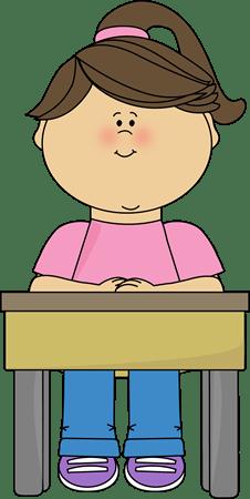 Girl Sitting at School Desk