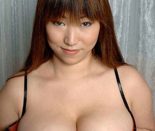 Busty Asian Milf In A Res Thong Black Stockings And Gloves Demonstrating Her Huge Titties