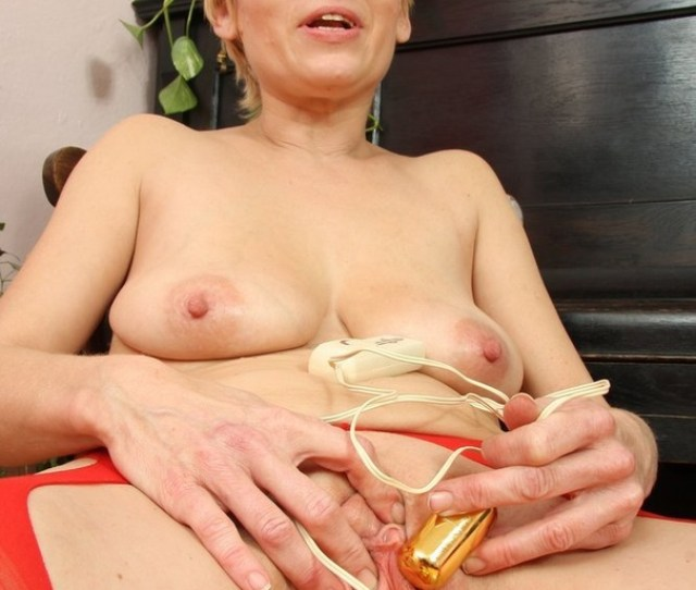 Blonde Momma With Short Hair Strips Nude And Plays With Golden Sex Toy