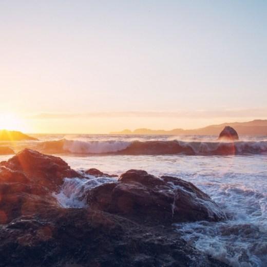 Sunset Waves Crashing Shore