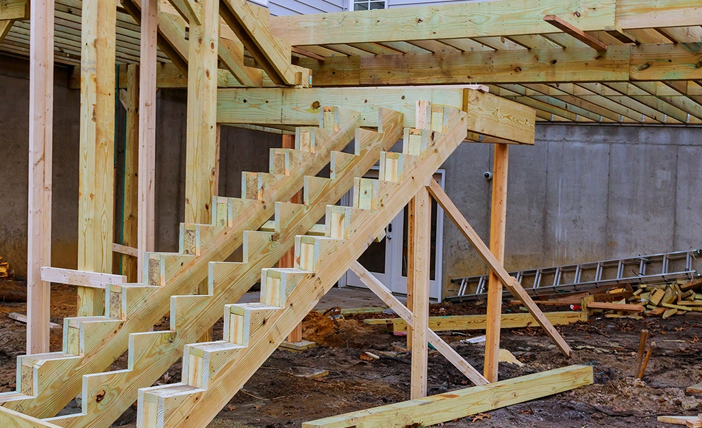 How To Build A Raised Deck The Home Depot   Building Outside Stairs To Second Floor   Handrail   Metal Staircase   Stair Treads   Stairs Leading   Spiral Stairs