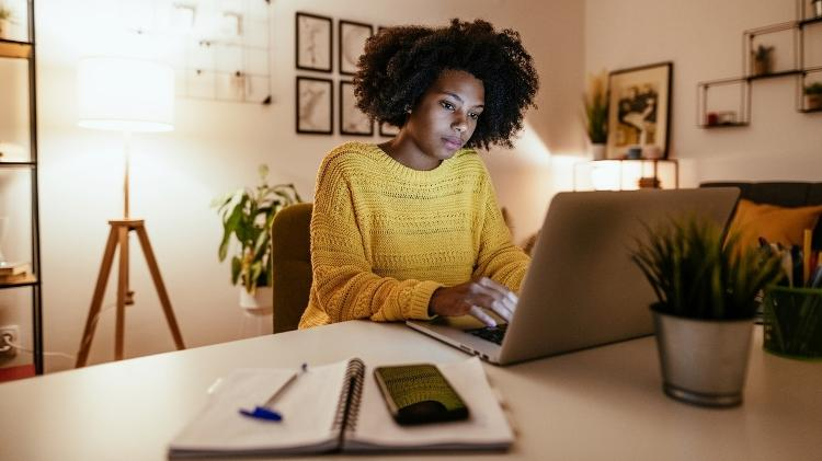 Overworked woman at home, home office, - iStock - iStock