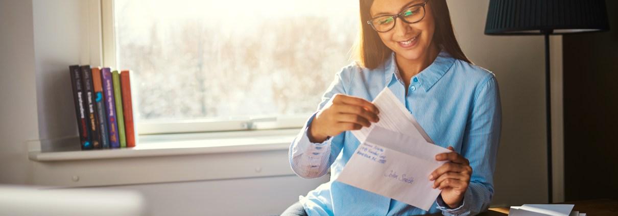 Woman opening an envelope