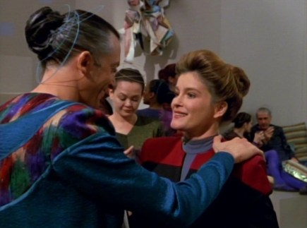 Gathorel Labin, a Sikarian male, greets Captain Janeway (2371)
