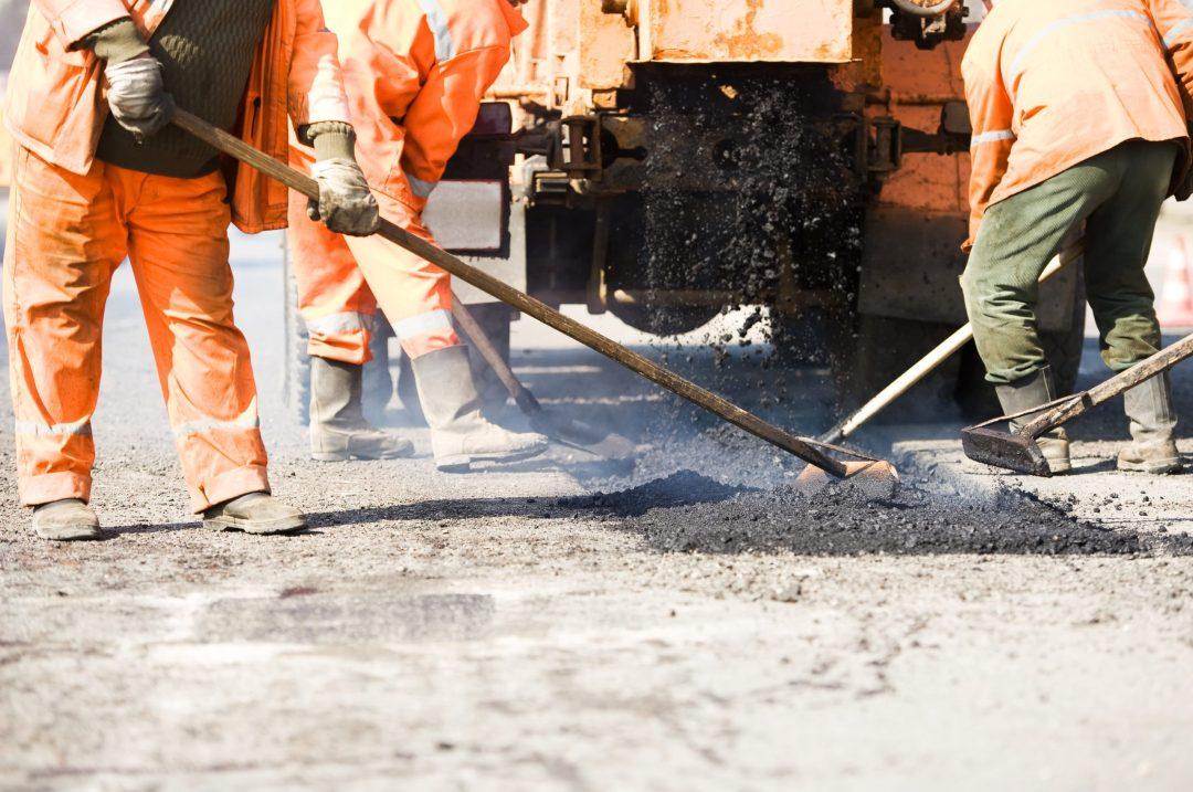 Contractors Paving A Road
