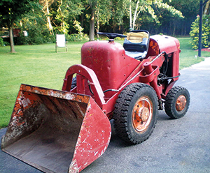 """Smallest of all the PayLoaders was the model HA. Ironically, it remained in production in variously modified form the longest of all, from 1947 through to 1982. This is a 19512 model about to undergo restoration. The """"half-hoop"""" houses the bucket tilt cylinder."""