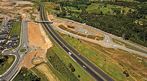Aerial view looking north on SH1 to the Wainui Road overbridge, with the on-and off-ramps to the left and right.