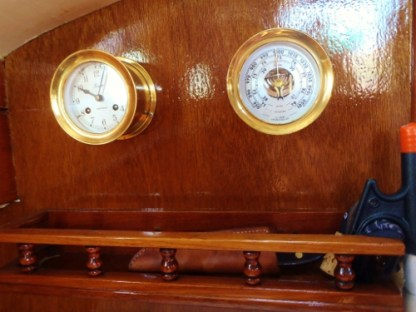 On the bulkhead forward of the port settee