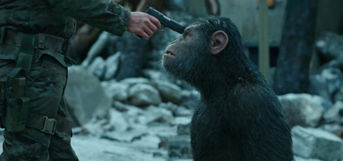 War For The Planet Of The Apes Film Review Caesar pointed by a gun