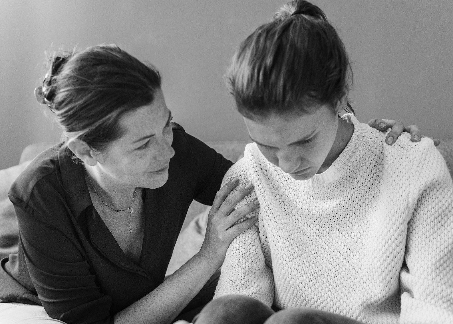 mother-consoling-her-sad-daughter 2