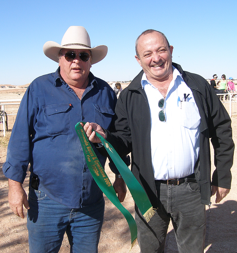 Robert Coro presents third place ribbon to Opal Inn manager Ken Williams for Snowby Boy