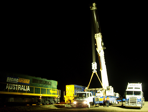 A huge crane travelled from Port Augusta to lift the coal train back onto the rails.  Photo: Nellie Malseed