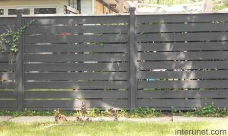 Gorgeous Black Wooden Fence Design Ideas For Frontyards 12